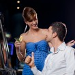 Young pretty couple in a casino — Stock Photo