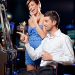 Young couple winning at the slot machine — Stock Photo