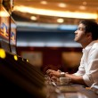 Royalty-Free Stock Photo: Casino slot machine player