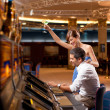 Couple playing the slot machine — Stock Photo #6277201