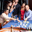 Stock Photo: Young betting roulette table
