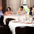 Sad young man at restaurant table — Stock Photo