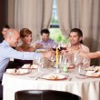 Stock Photo: Young toasting restaurant table