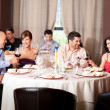 Young toasting restaurant table — Stock Photo #6277225