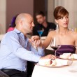 Couple flirting at restaurant table — Stock Photo