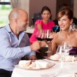 Young couple toasting restaurant table - Foto de Stock  