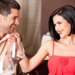 Young couple flirting at restaurant table — Stockfoto