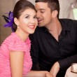 Young couple flirting at restaurant table - Photo