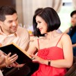 Stock Photo: Young couple ordering food restaurant table
