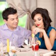 Man flirting, woman annoyed at restaurant table — Stock Photo