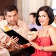 Young couple ordering food restaurant table — Stock Photo