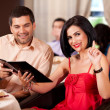 Young couple calling waiter restaurant table — Stock Photo #6277258