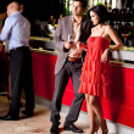 Young couple in bar having fun — Stock Photo