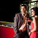 Young couple at bar counter talking — Stock Photo