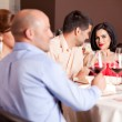 Happy couple at restaurant table talking — Stock Photo #6277277