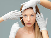 Young woman having botox injection — Foto Stock