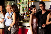 Young at bar counter — Stock Photo
