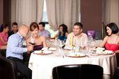 Young flirting restaurant table — Foto de Stock