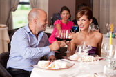 Young couple toasting restaurant table — Stock Photo