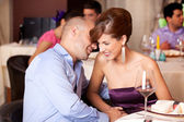 Young couple flirting at restaurant table — Stock Photo