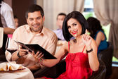 Young couple calling waiter restaurant table — Stock Photo