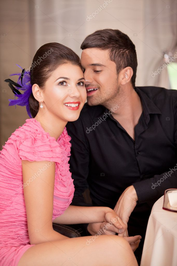 Happy happy couple flirting at restaurant table — Stock Photo #6277252