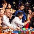 Happy caucasian friends playing roulette in casino — Stock Photo #6653237