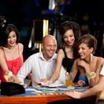 ������, ������: Happy caucasian friends playing blackjack in casino