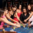 Стоковое фото: Smiling and dealer playing roulette