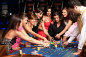 Smiling and dealer playing roulette — Stok fotoğraf