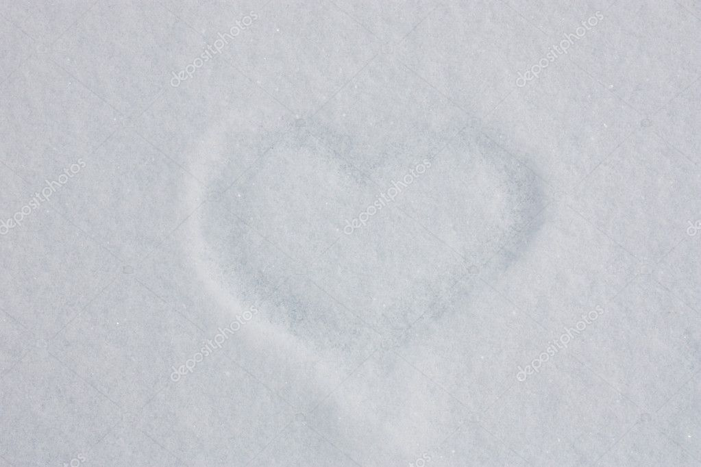 Heart drawn by finger on snow. — Stock Photo #5485558