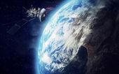 Satellit und erde — Stockfoto