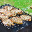 Steaks in Barbecue grill — Stock Photo