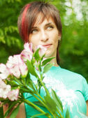 Pretty girl with soft flower — Stock Photo
