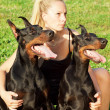 Pretty women with own dobermans - Foto de Stock