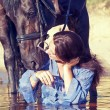 Kiss of pretty girl to yours  horse - Stock Photo