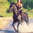 Sexy women galloping  on  horse at lake — Stock Photo