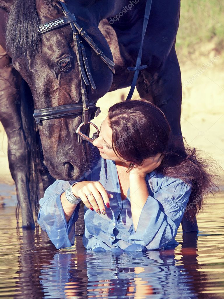 Kiss of pretty girl to yours  horse — Photo #6304319