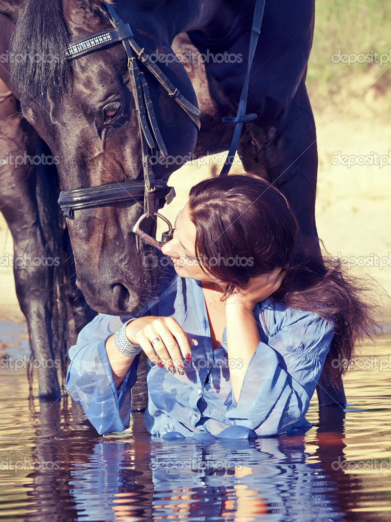 Kiss of pretty girl to yours  horse  Stock Photo #6304319
