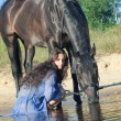 Stok fotoğraf: Pretty women with yours horse in lake