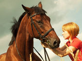 Portrait of young girl with horse — Stock Photo