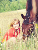 Pretty young girl with horse in fild — Stock Photo
