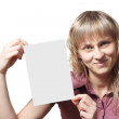 Young woman holding a business card — Stock Photo