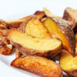 Stock Photo: Potato wedges roasted in their skins