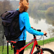 Tourist with bike and backpack — Stockfoto