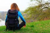 Woman traveler on a halt — Stock Photo