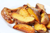 Potato wedges roasted in their skins — 图库照片