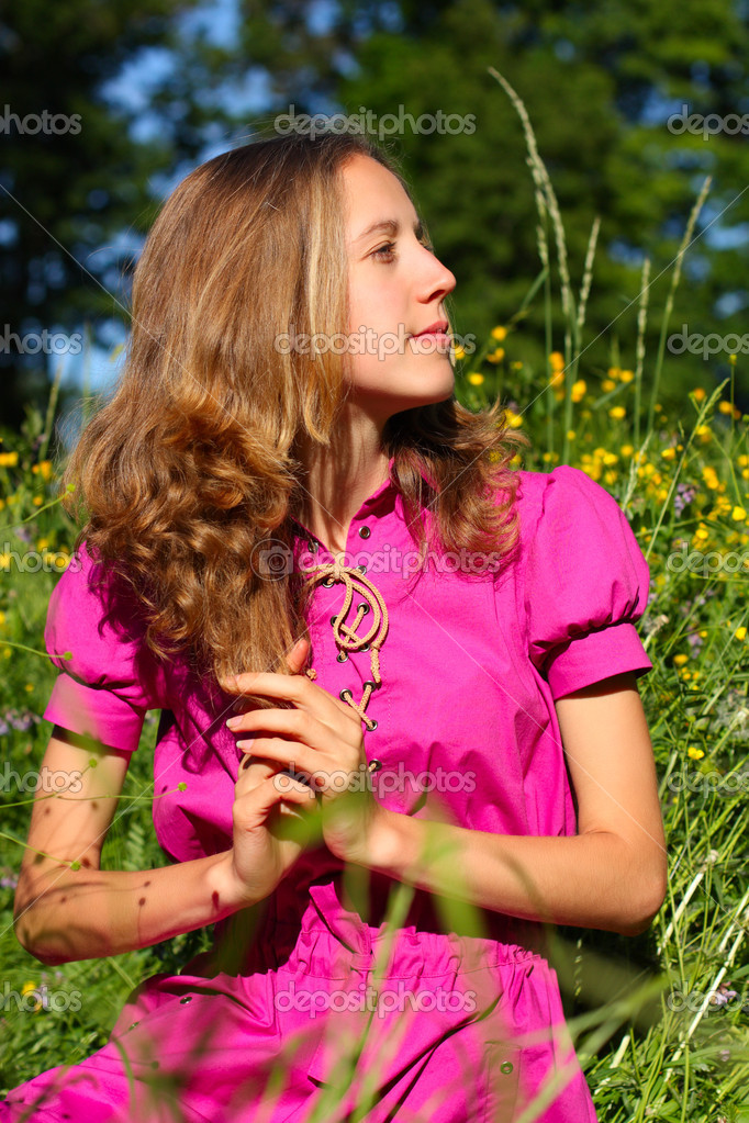 A beautiful young woman in a meadow full of flowers — Stock Photo #5827148