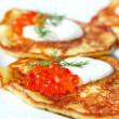 Potato pancakes with red caviar — Stock Photo #5931992
