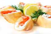 Pancakes with salted salmon and feta cheese — Stock Photo